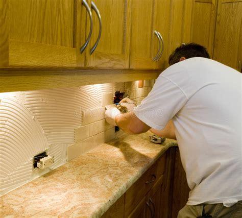 ceramic tile installation on kitchen backsplash 10 royalty free stock images image 13321289 ceramic tile installation on kitchen backsplash 12 stock