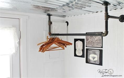 laundry room hanging clothes rack made from pipes