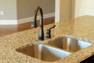 pictures of stainless steel sink with rubbed bronze faucet