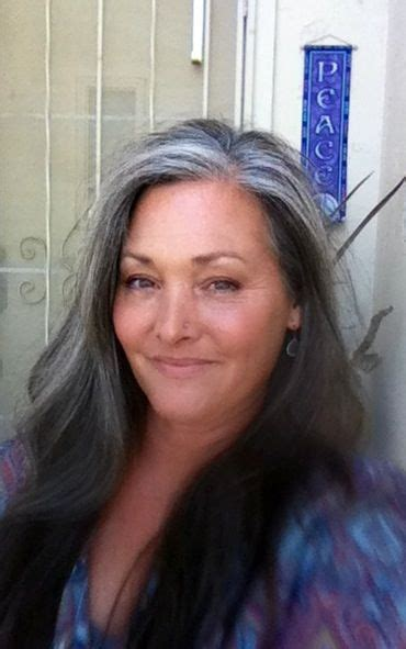 lovely grey streak hair getting more gray she is lovely silver style pinterest