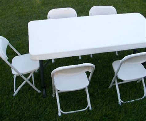 White Folding Table And Chairs Table And Chair Rentals Happy Rentals