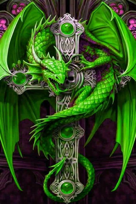 green dragon tattoo on a celtic cross in green by stokes