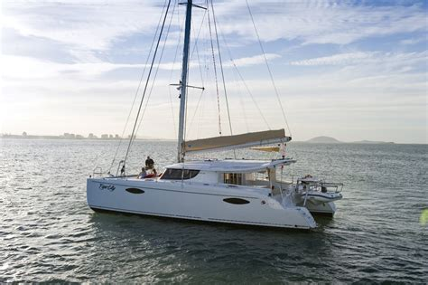 catamaran hire cairns port douglas private charter boat day afternoon or