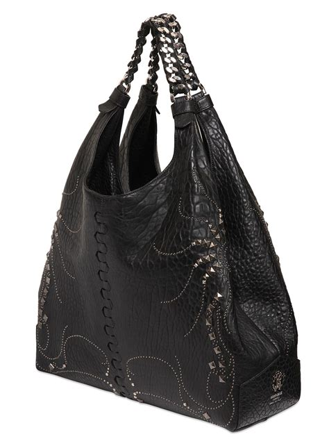 Roberto Cavalli Rome Leather Hobo by Roberto Cavalli Studded Nappa Leather Hobo Bag In