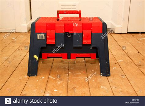 Step Stool Toolbox by Step Stool Toolbox On Bare Floorboards Stock Photo