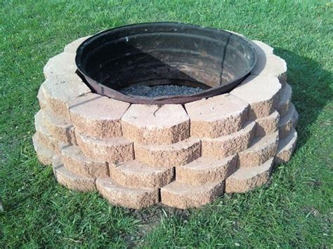 tractor wheel pit firepit made with castle rock and an tractor tire