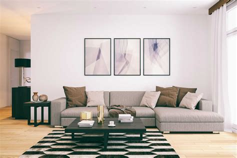 hanging pictures over sofa how to hang picture frames mistakes to avoid reader s