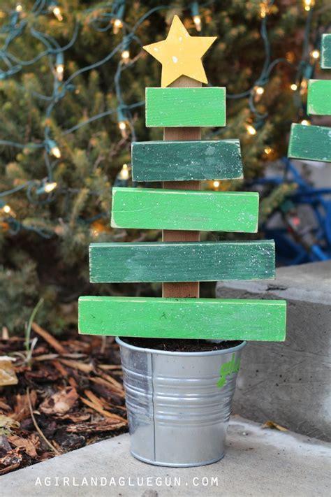 christmas tree  scrap wood  girl   glue gun