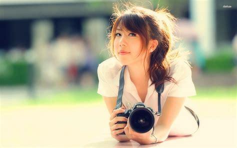 girl with camera wallpaper hd girl with a nikon camera wallpaper