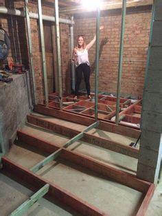 Raised floor in a log home bathroom to hide the plumbing