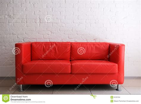 brick red sofa red sofa and brick wall stock images image 6123704