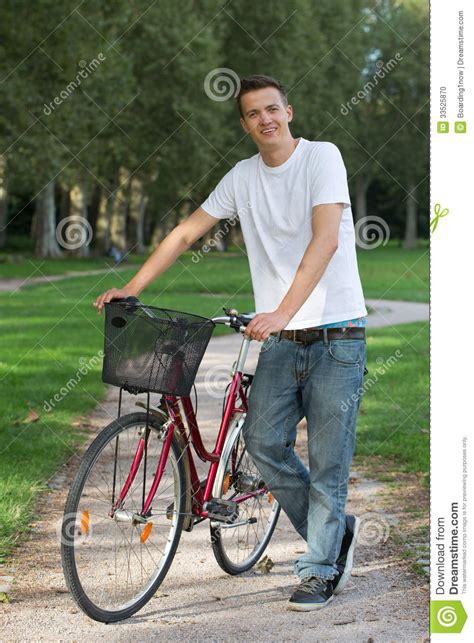 Next Standing L by Standing Next To His Bike Stock Photo Image