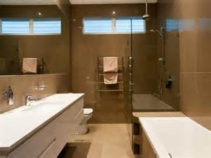 Modern bathroom design with recessed bath using frameless