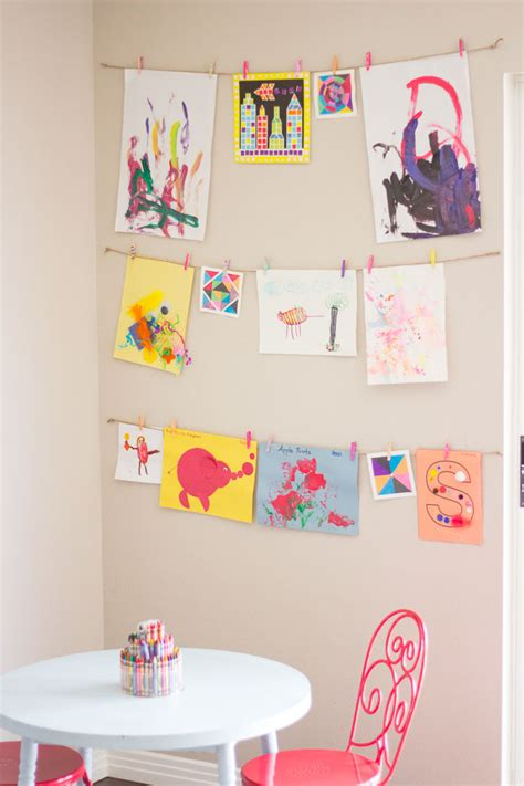 hanging kids artwork the simplest way to display your kids art design