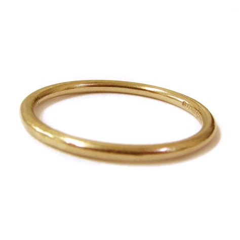 thin 18k yellow gold stacking ring catherine marche