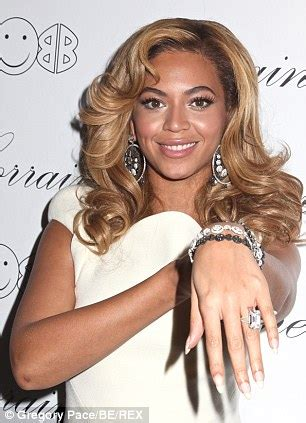 tattoo lasering cost beyonce displays faded wedding ring tattoo sparking