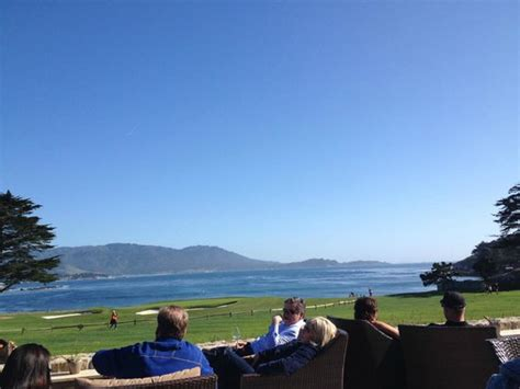 the bench at pebble beach pebble 6th hole in the background picture of the lodge