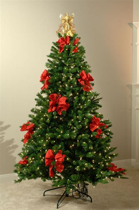 christmas tree decorations with red ribbons christmas