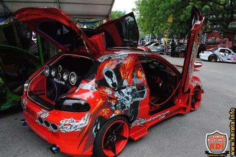kereta mitsubishi lama modified satria custom body kit in red with scissors door