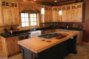 Rustic bi colored knotty pine cabi and wooden island with cook top