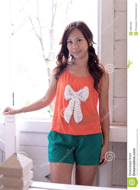 Bow Window Prices women in orange shirts and green shorts royalty free stock