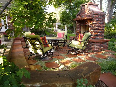 Back Patio Designs Tasty Outdoor Backyard Patio Ideas With Great Brick Fireplace Facing Cozy Green Sofa Patio