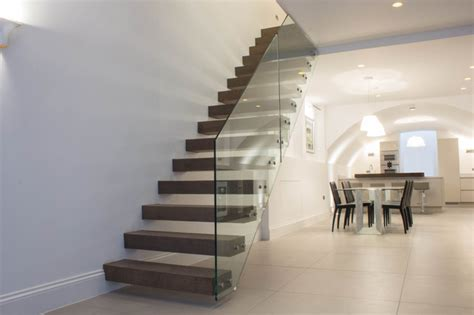 floating staircase in dark walnut treads modern staircase london by railinglondon ltd