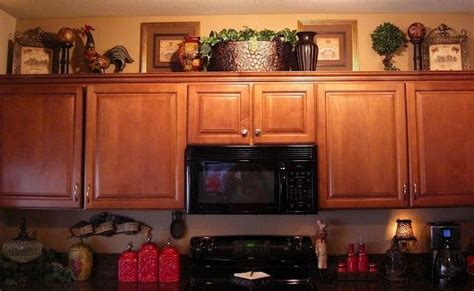 how to decorate on top of kitchen cabinets on top of cabinet decor home ideas