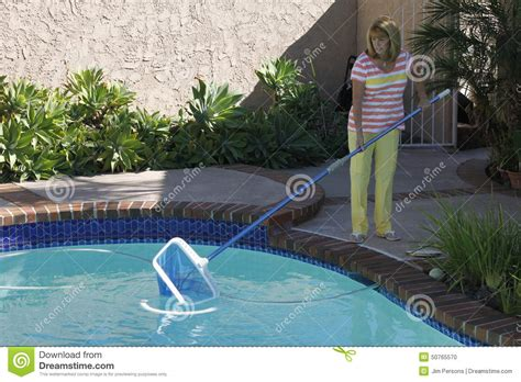 woman cleaning her swimming pool stock photo image 50765570