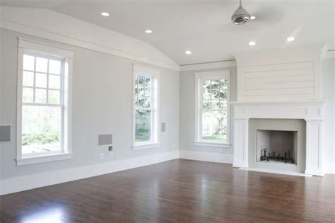 den family room living room light gray walls with white trim wood floors let the room be