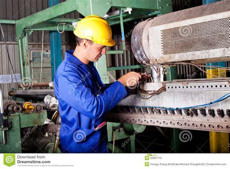 mechanic repairing heavy machine stock photo image of