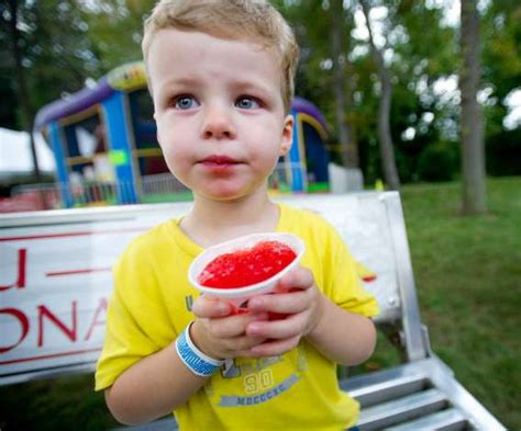Lindsay Eats Chocolate And Runs In A by Brian Lamonica Tries Hoop At The St Leo Summer Fair