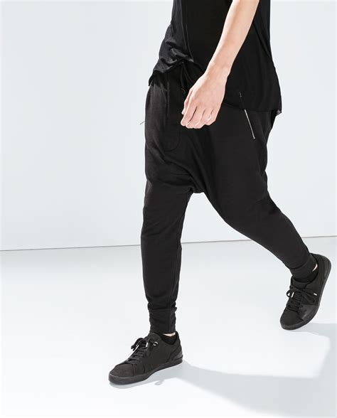 zara baggy trousers with zips zara baggy trousers with zips in black for lyst