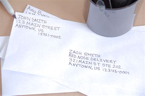 where do you write the senders address on an envelope youtube