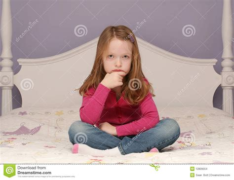 girl sitting on bed young girl sitting on bed stock images image 12809554