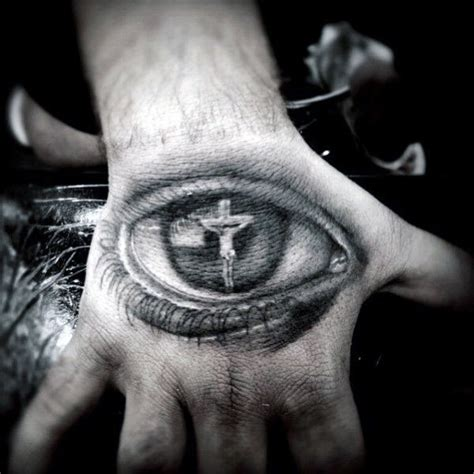 cross tattoo next to eye meaning 20 jesus hand tattoo designs for men christ ink ideas