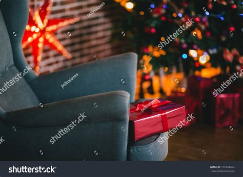 under the christmas lights presents the tree lights background stock photo 519744664