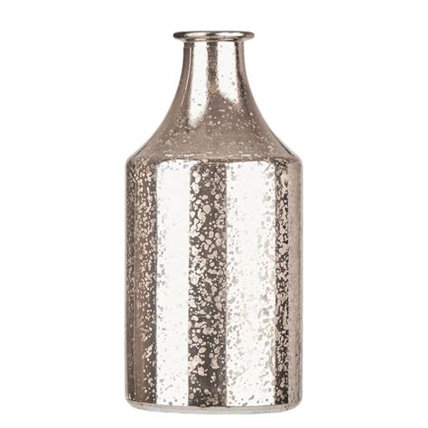metallic mirrored silver vase by the home