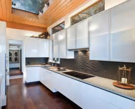 black graphic wavy backsplash kitchen wooden floor island