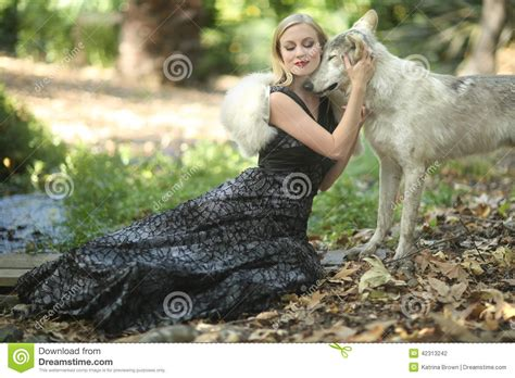 beautiful outdoors lovely posing with a wolf stock photo image 42313242