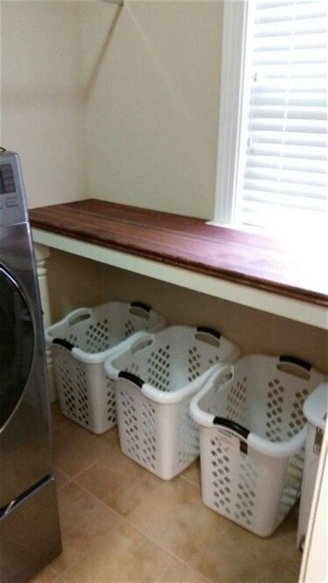 laundry room folding station 25 best ideas about laundry folding station on laundry basket storage utility room