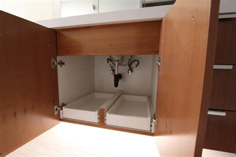 bathroom under cabinet organizers bathroom under cabinet storage with help from the kitchen