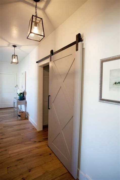 barn door lighting photography gray barn door transitional entrance foyer utah