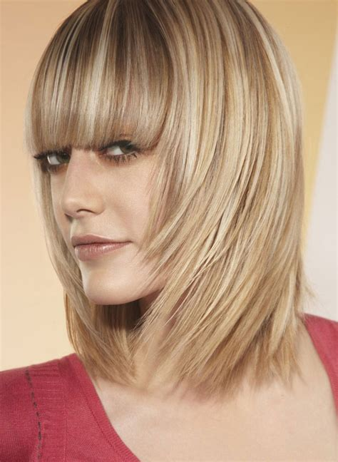 ladies choppy hairstyles with a fringe choppy layered bob with full bangs hairstyles for round