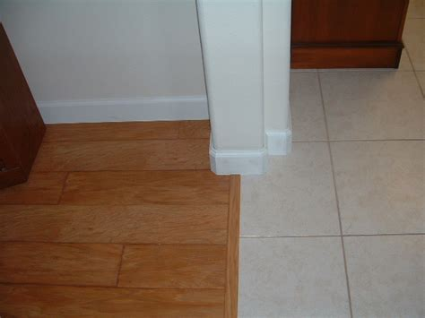 Baseboard Different Floor Heights by Laminate Flooring Photos