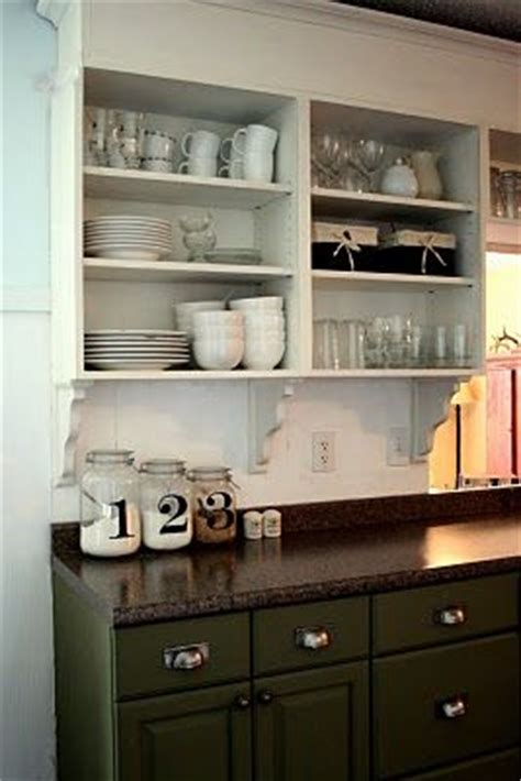 kitchens with shelves green love the look of cabinets with no doors i think it would