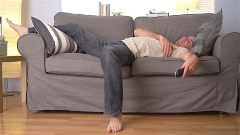 sleep on the sofa man trying to sleep on couch stock footage video 6598763
