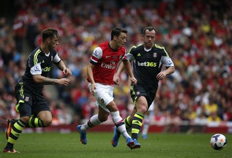 arsenal standing ozil lifts arsenal to top of premier league standings ny