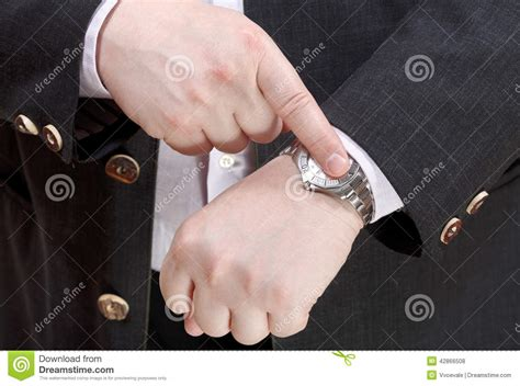 Offical Time by Show Exact Time On Wristwatch Up Stock Photo