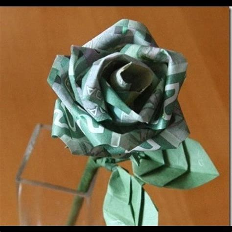 Origami In Bloom - money in bloom origami flower photograph by ho